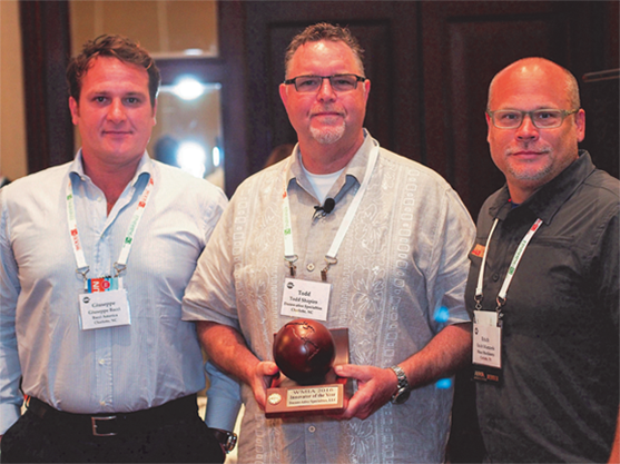 Todd Shapiro receives wooden globe award as the WMIA 2916 Innovator of the Year