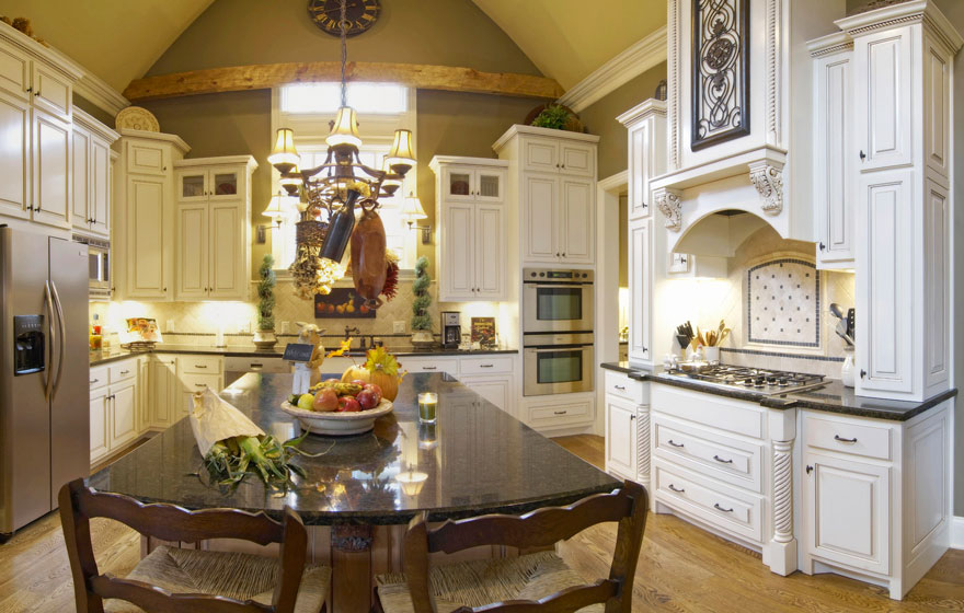 Tall cabinetry in a stunning arched ceiling kitchen creates a dramatic space.