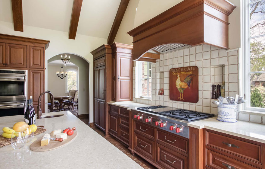 A customized door style is featured in this beautiful, bright kitchen.