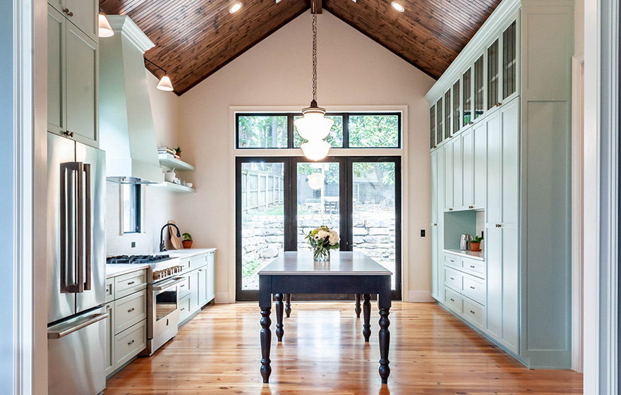 Stunning green painted cabinets perfectly accent the space