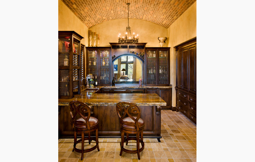 "Dramatic ceilings and stonework provide a great backdrop to feature the Malibu 7/8"" (50) Door style and some custom designed doors."