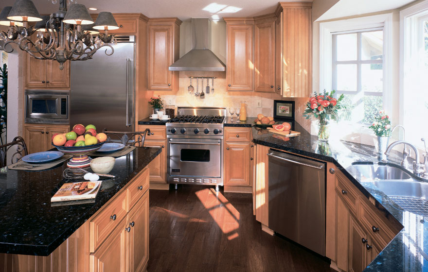 """A light, airy environment is perfectly complemented with Maple cabinetry in our Delaware 7/8"""" (538) Door and beaded end panels."""