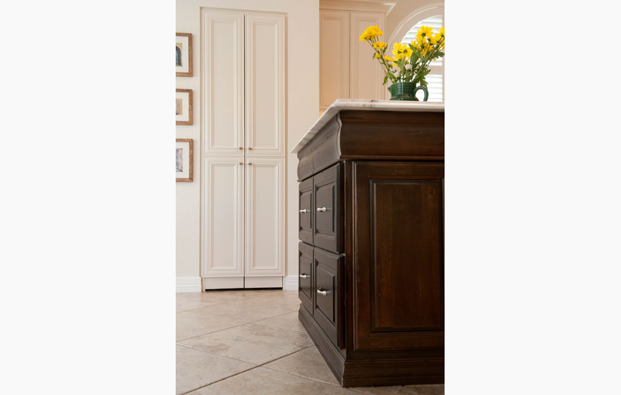 Two door styles, two materials, and two finishes are perfectly paired for a stunning look and a beautiful backdrop for the two specialty doors as a focal point.