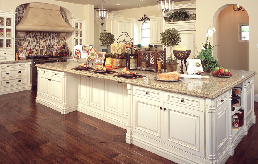 Dramatic size and stature make this lavish kitchen awe-inspiring while built-in eating areas and smart layout design help retain its everyday practicality for making a house a home.