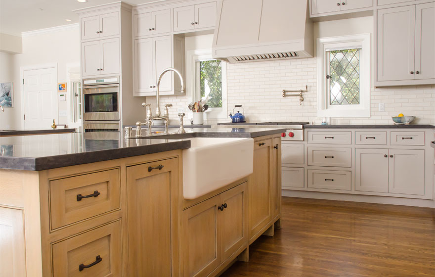 Rift Sawn White Oak pairs with painted cabinetry for a chic look in this large kitchen featuring dual islands.