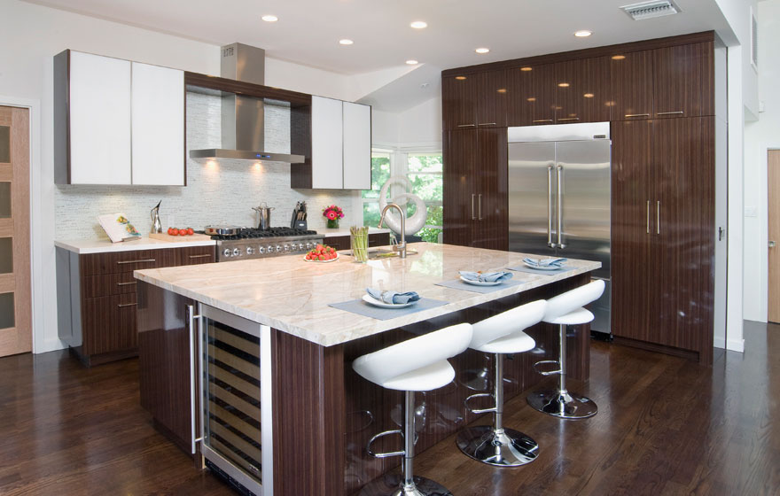 """The high gloss finish and detailed wood grain look is smartly paired with the DBQ 3/4"""" (816) Slab Door style to allow the stunning material to be the star."""
