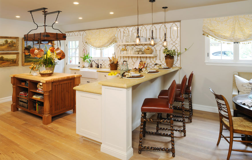 Perfectly designed from top to bottom, this kitchen uses two door styles, two Designer Face Frame edges, and two beautiful finishes to create a unique and inventive space.