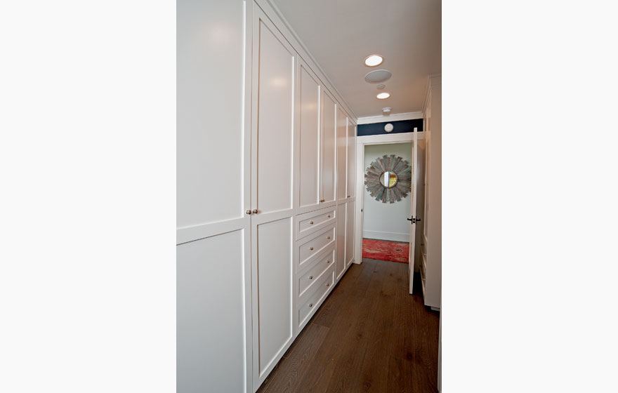 "Built-in closet doors using the Durango 3/4"" (834) Door maximize space and create a clean look."
