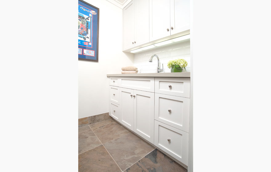 """Keep laundry spaces looking clean and crisp with the simple Durango 3/4"""" (834) Door in a classic white paint color."""