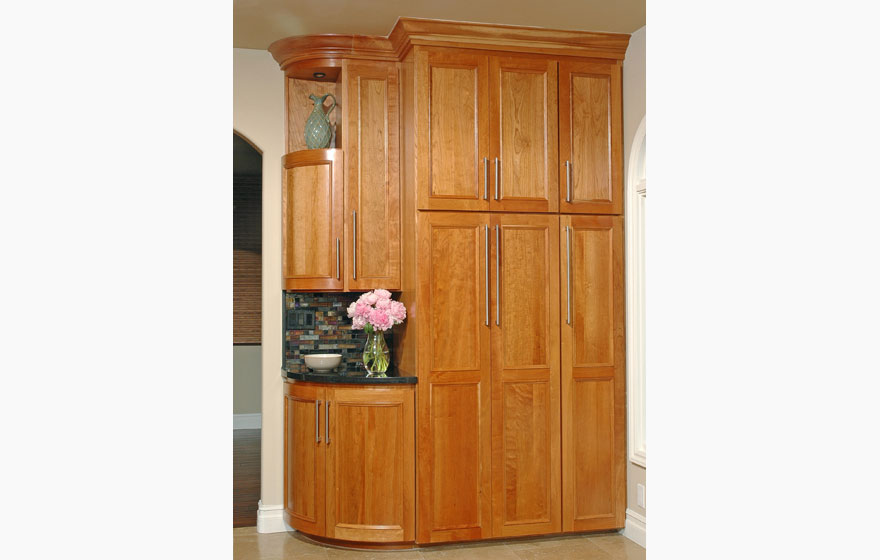 Let the beauty of cherry shine through by using a clear or light stain and using dark tile and granite to make the cabinetry the focal point.