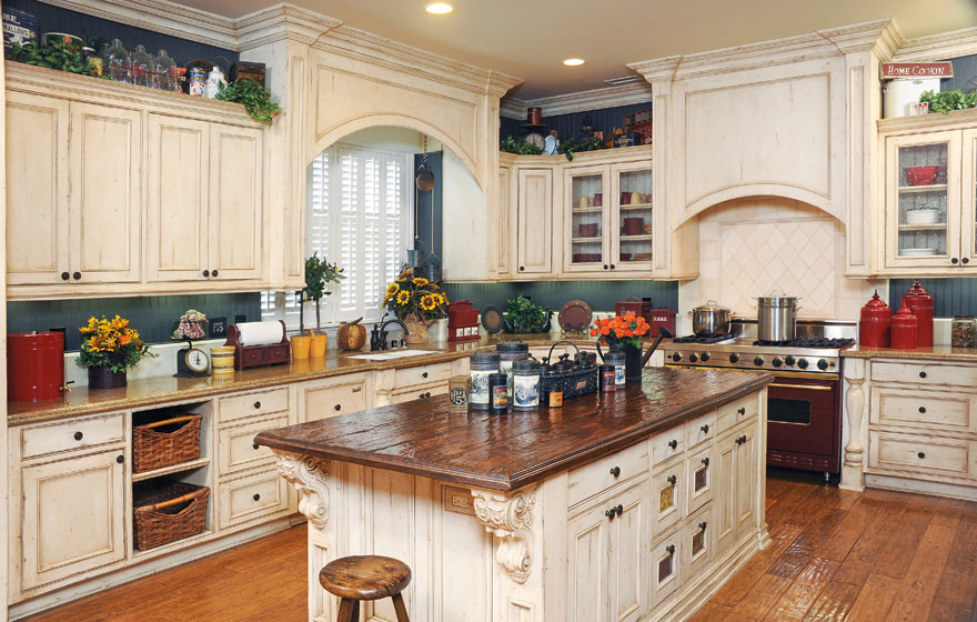 A large island and the tops of upper cabinets become a perfect home for containers and treasures to add a stylized look.