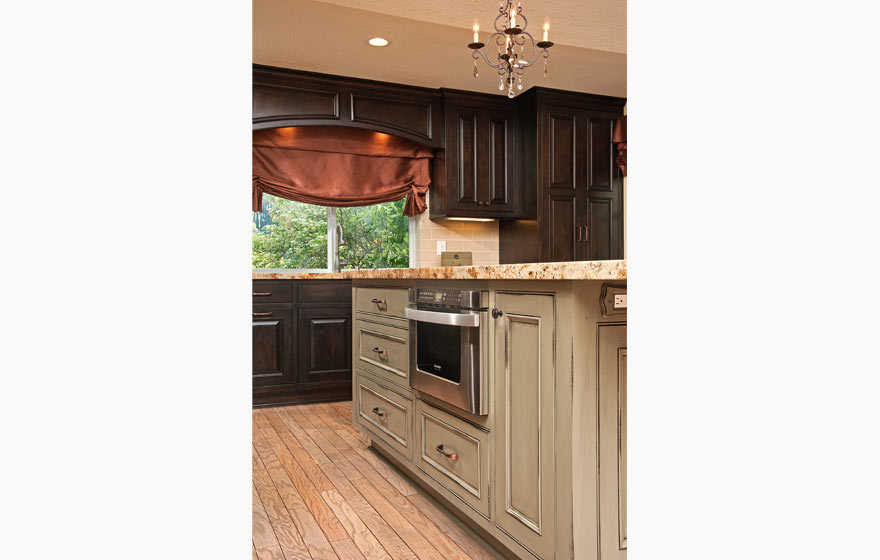 """Charm and elegance are incorporated into the gathering place for a family, featuring Custom Applied Molding and Laguna 3/4"""" (853) Doors."""