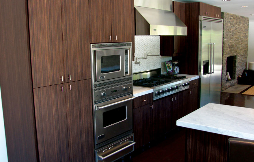 """Using a dramatic reconstituted veneer, like Quartered Macassar Ebony, on the Aries 3/4"""" (93) Veneer Door pairs perfectly with contemporary, clean lines so the drama of the material is the focal point."""