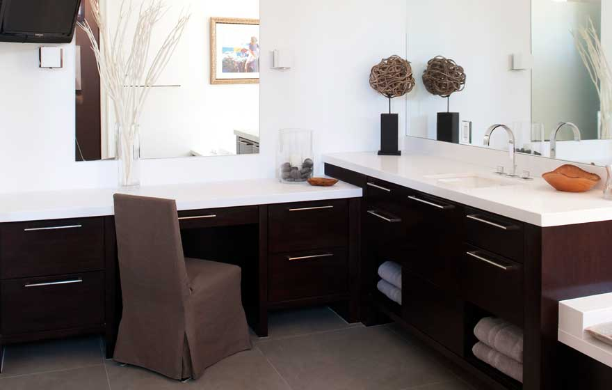 Using a simple door style and contrasting cabinets and countertops maintains a clean and sharp look.