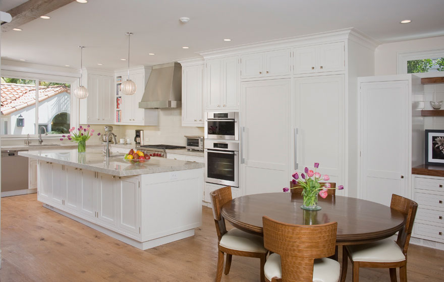 Custom designed wood cabinet doors were used in this stunning kitchen and dining space to bring a truly high end look.