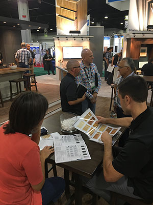 Shawn Potts, Midwest Regional Sales Manager, reveals our new Wood catalog! Shawn Sievers, Northern CA Sales Manager (foreground) explains the benefits and features of our Elk Grove, CA drawer box offering.