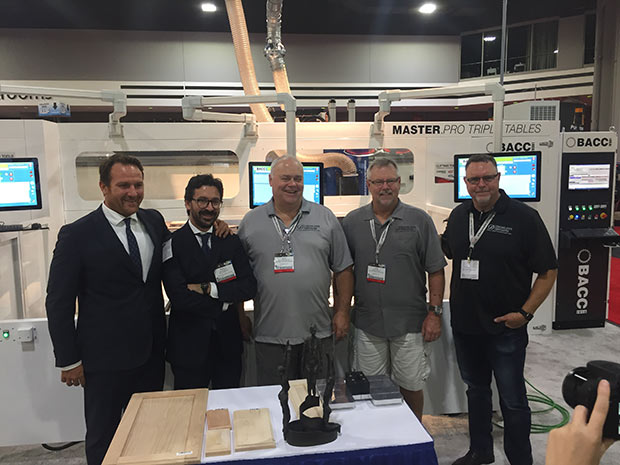 Bacci company (left) received the 2016 IWF Challengers Distinguished Achievement Award for their collaboration with Todd Shapiro (right) and the Monroe facility. Also pictured is Jack Lansford, Jr., President of Decore-alive Specialties (center) and Jack Albright, Vice President of Elk Grove, CA operations.