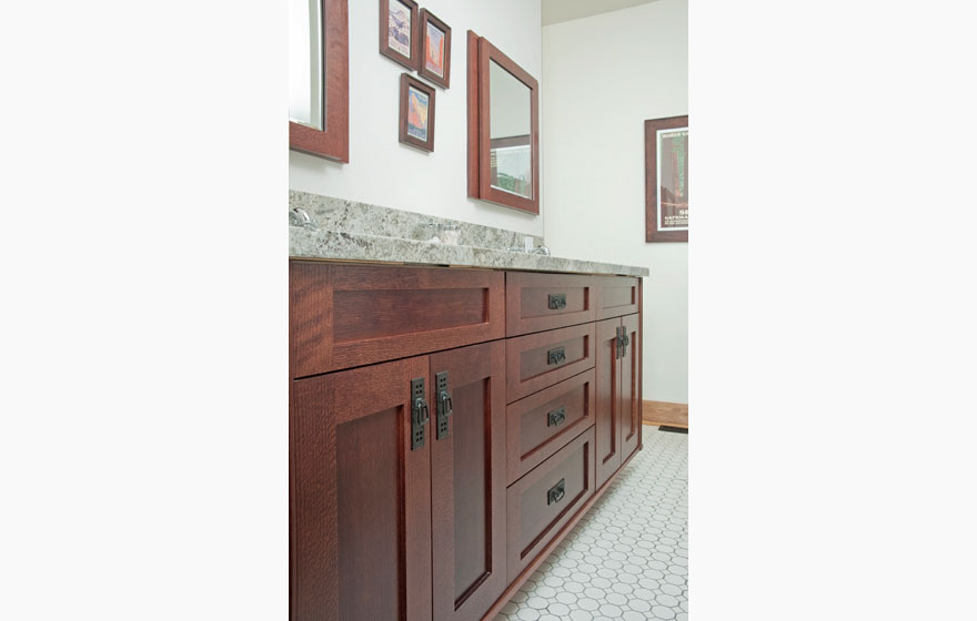 craftsman style bathroom with shaker cabinet doors in quarter sawn red
